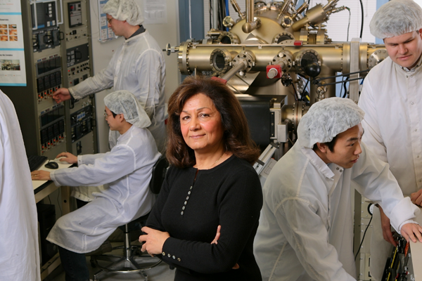 Image or Professor Razeghi in the lab surrounded by her students.